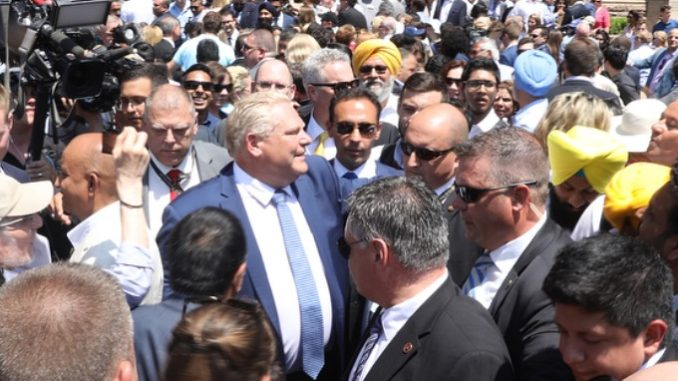 Doug Ford walks the crowd at his swearing in ceremony.